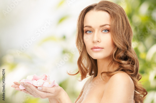 beautiful woman with rose petals
