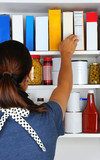 Woman Reaching Into Pantry