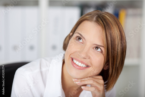 Portrait of a smiling woman at the office