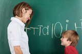 Happy little boy with his teacher