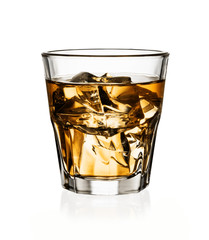 Glass of whiskey with ice isolated on white