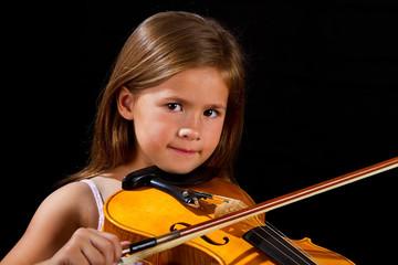 Girl playing violin in pink dress