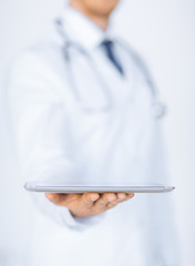 male doctor holding tablet pc