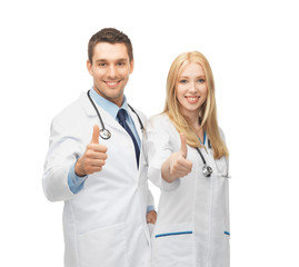 young team of two doctors showing thumbs up
