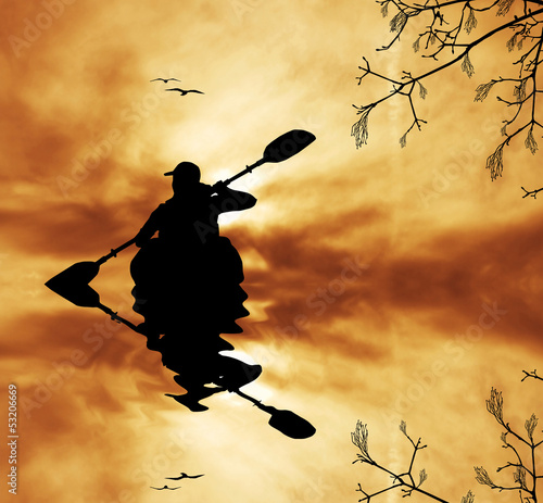 Kayaker silhouette at sunset