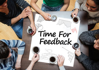 Time for feedback written on a poster with drawings of charts