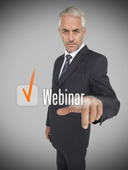 Businessman selecting the word webinar