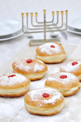 Hanukah doughnuts, sufganiya and menorah