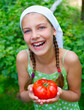Girl holding a tomato