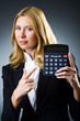 Businesswoman with calculator in business concept