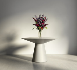 Elegant luxury entrance round table with flowers in a vase