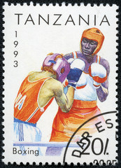 stamp printed in Tanzania shows boxing