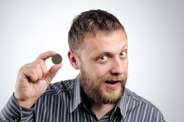 Businessman with a coin. The concept of saving