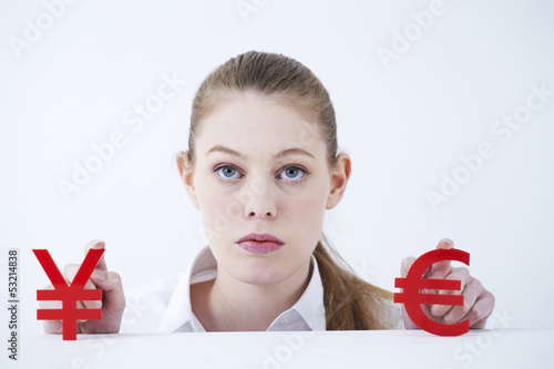 Businesswoman with dollar euro sign