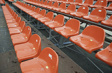 Rows of red wet bleachers