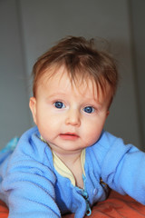 Charming blonde baby with blue eyes