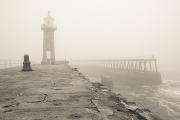 Whitby pier and lighthouse