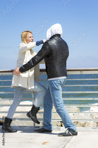 woman Defending Herself Against assailant