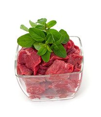 pieces of fresh beef in a glass bowl