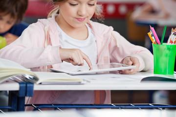 Schoolgirl Using Tablet At Desk