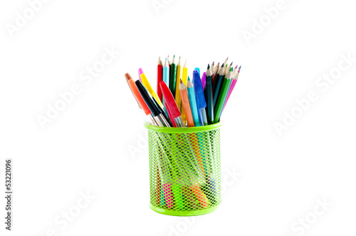 Stationery. Colored pencils in a pencil stand over white backgro