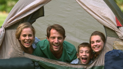 Happy family having fun together in a tent