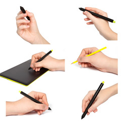 isolated hands with pencil draws something