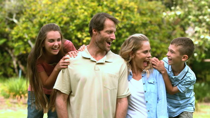 Smiling family spending time together in a park