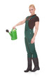 Portrait Of A Female Worker Holding Watering Can