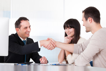 Consultant Shaking Hands With A Man