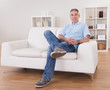 Mature Man Sitting On Sofa