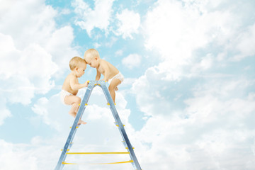 Baby competition for first place, stepladder over sky clouds