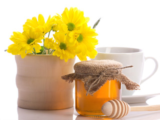still of honey, flowers and cup
