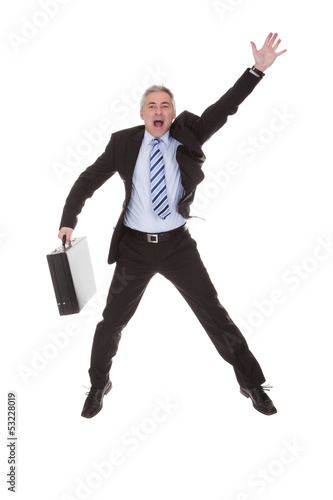 Worried Businessman Hailing A Cab