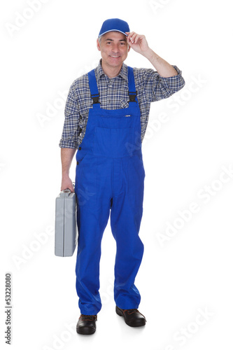 Mature Male Technician Holding Worktool
