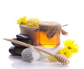 spa still with honey and flowers