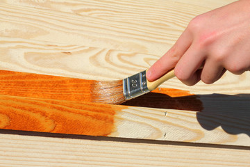 Painting wooden furniture piece