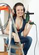 Happy  sexy builder in headphones