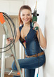 young happy sexy woman with drill