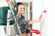 Happy girl  makes repairs at home