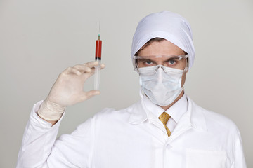 Confident surgeon holding a syringe