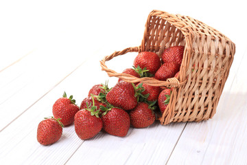 underlying basket of strawberries spilling