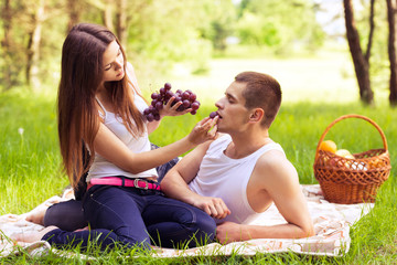 woman feeding man grapes