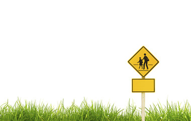 Traffic sign (School warning sign) on grass.
