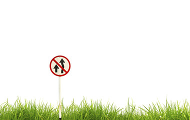 Traffic sign and fresh spring green grass isolated on white back