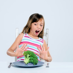 Young kid refuses to eat broccoli