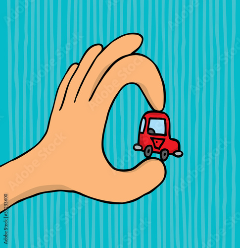 Hand holding tiny car