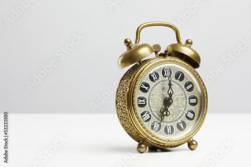 Old antique brass alarm clock