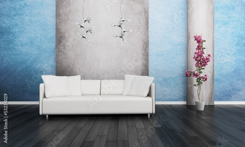 Modern white couch in front of blue and grey wall