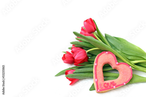 Bouquet of tulips and sugar heart on a white background